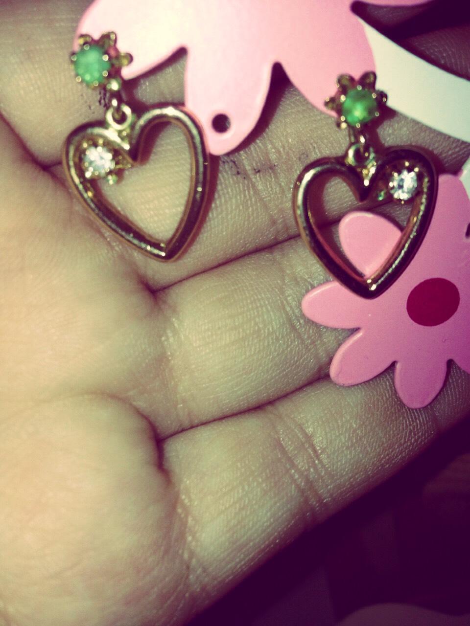 For earrings I am wearing a heart earrings