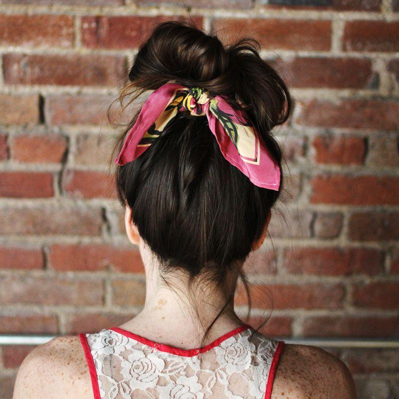 Style your hair in a messy bun and tie the scarf around the base of the fun with the knot in the back.