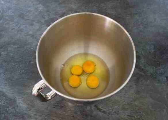 Break the eggs into the bowl of an electric stand mixer. (or, if using an electric hand whisk, a very large glass bowl.)