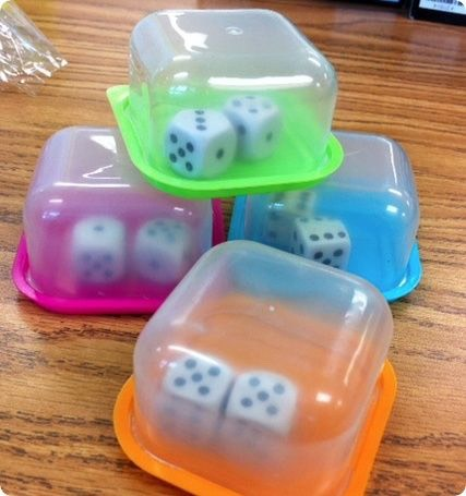 I love these Dice shakers, they are great for travel games and smaller hands. Use small plastic storage containers and you are set!