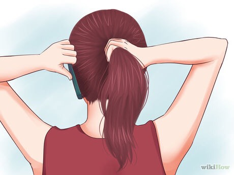Comb your hair to prevent bumps. You can use a comb or simply run your fingers through your hair while you're gathering it into a ponytail. If you prefer to have a messy ponytail, you don't need to check for any lumps.