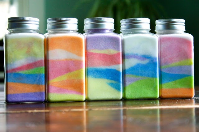 Fill the jar with different color salt in different shapes (you can keep it like a home decoration or keep a little space on the top so you can poke in anything you like...like