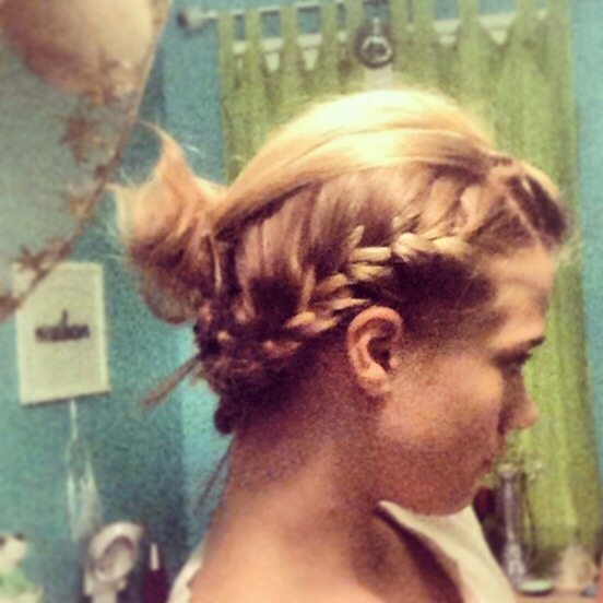 Messy french braid into a teased/messy  bun