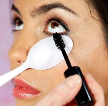 Putting a plastic spoon under your lower lashes really helps with applying mascara! It can also be used for the upper by pulling your eye lid up, exposing your lashes