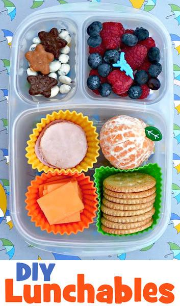 crackers, sliced cheese and lunch meat, clementine and mixed berries