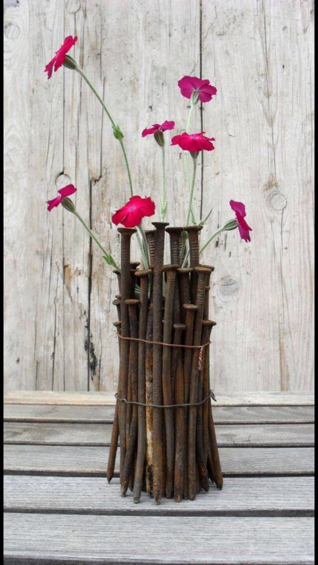 Simply glue nails to a vase and add some flowers!!