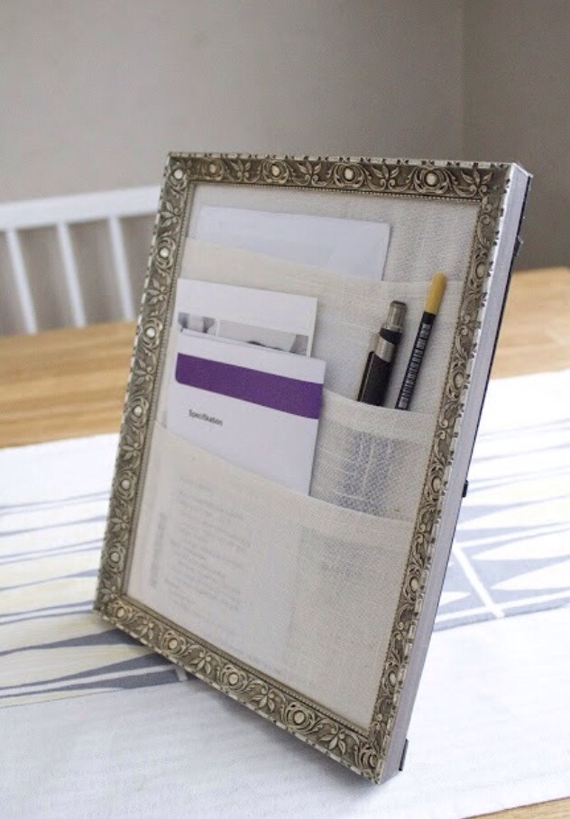Frame a few layers of fabric in your favorite picture frame with the glass removed for a DIY desk organizer