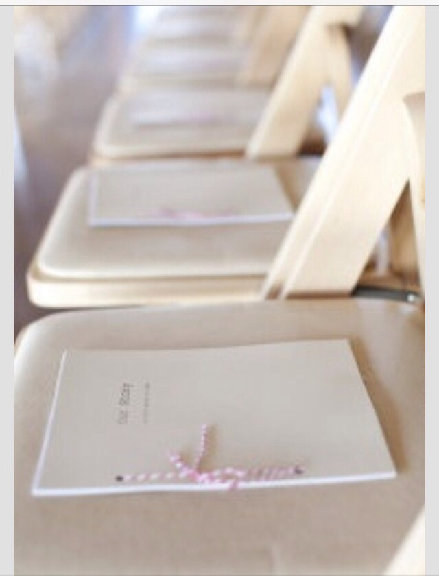 """Our story"" on the seat of each chair. A cute idea and something to look at while the guests wait for the ceremony to begin."