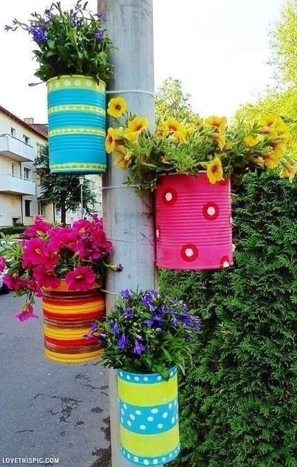 No more room on the ground? Insert a pole if you dont already have one from a gazebo, paint some cans, grab some flowers and hang them up to continue extending your garden!