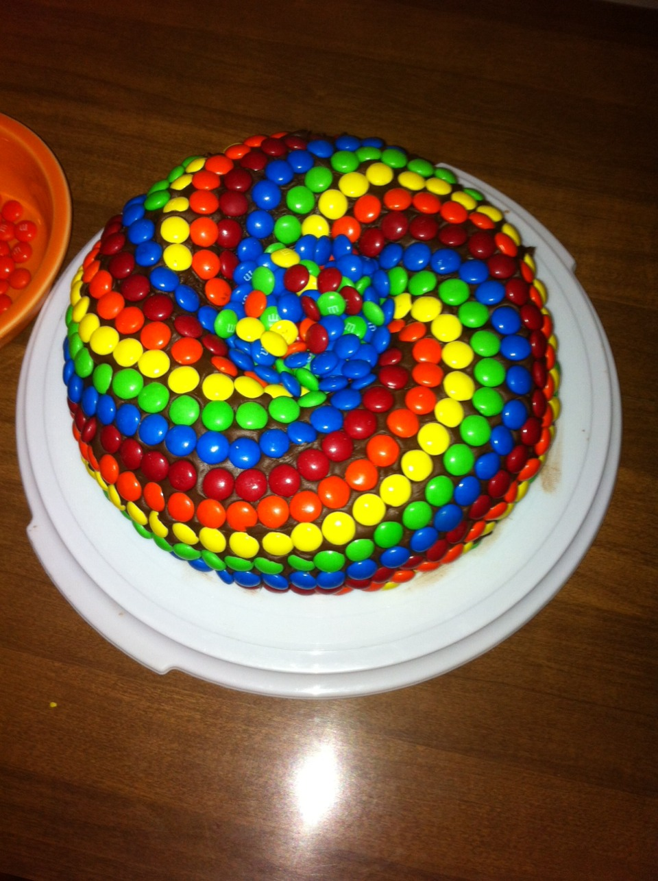 Lastly, decorate your cake like you want to! Another optional step is to fill the center of your cake with your left over M&M's!