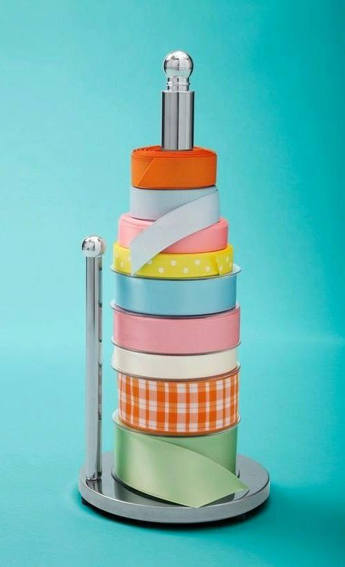 Paper towel holder to hold your rolls of tape.