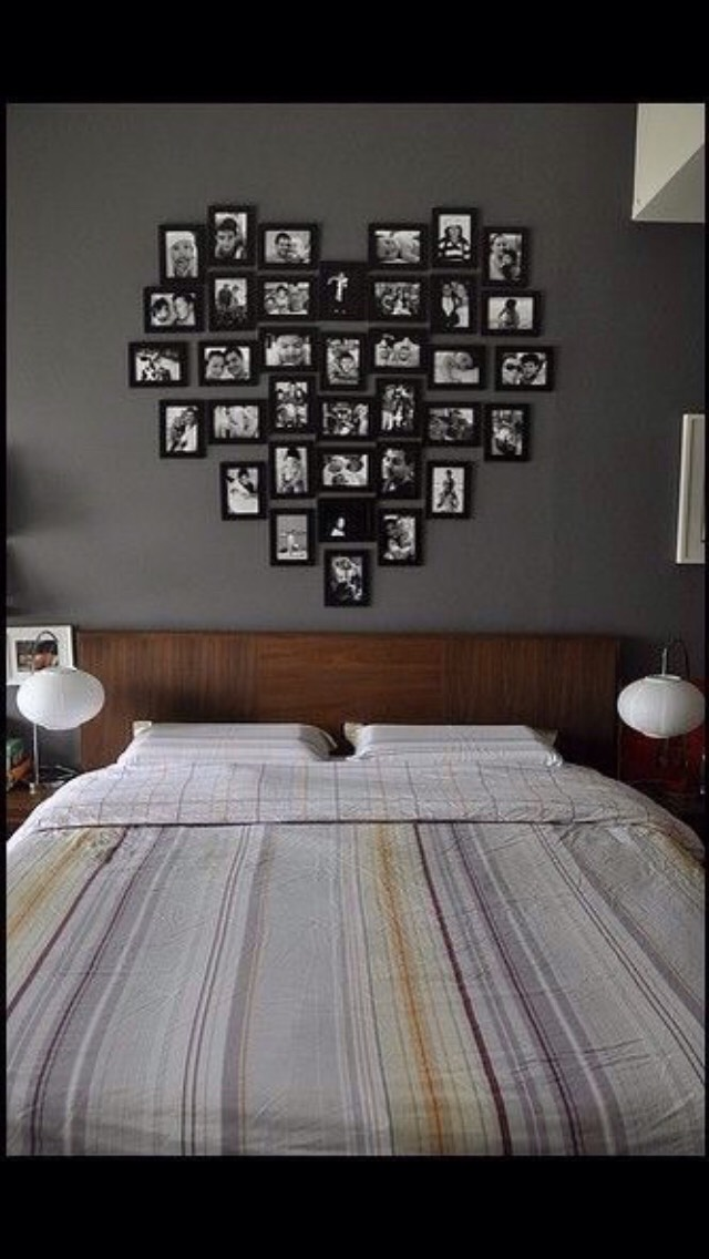 Buy lots of frames, put cute pics, then hang them up in a cute design!