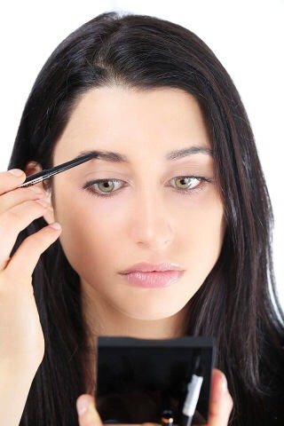 STEP 4  Using short, dash-like strokes to mimic your natural hairs, softly fill in any sparse areas with a pencil. Choose a colour that matches your brows and fill in really lightly so it's barely there.