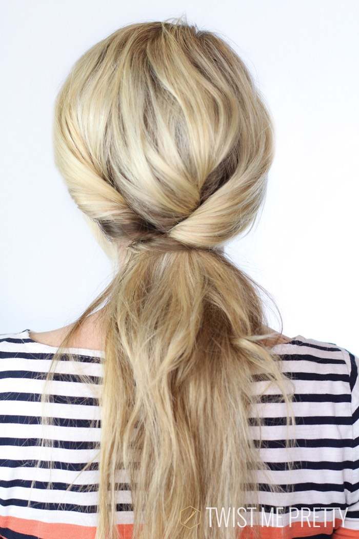 Put your hair into a loose ponytail. Divide the pony tail into two sections. Twist two sections and wrap it around the other section to create the casual twisted ponytail☺️