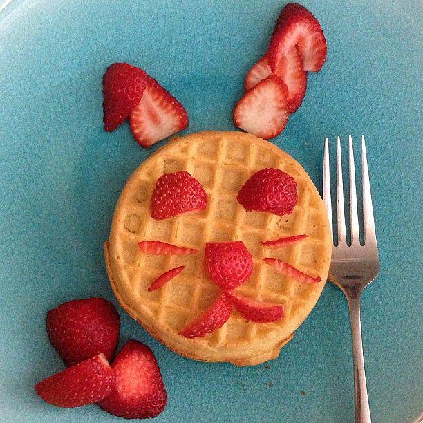 A Hoppy Breakfast To amp up a frozen waffle, cut up some strawberries and place them in the shape of a bunny.