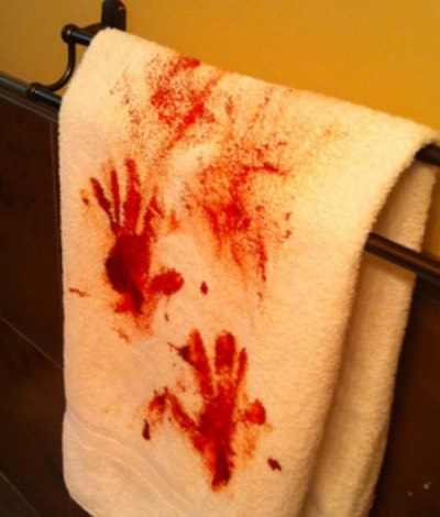 you need red paint or fake blood (again) get a cheap white towel and pour red paint or fake blood all over you hands and wipe your hands on the towel