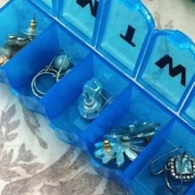 Another great traveling tip for your jewelry! Place rings and earrings in one of those daily pill boxes to keep them safe and organized.
