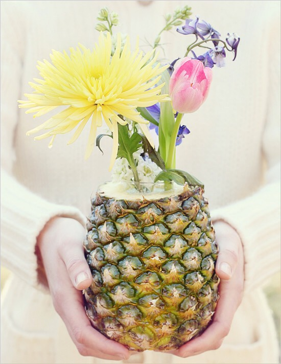 Anyone can make this simple and budget-friendly Do It Yourself Fresh Fruit and Flowers Centerpiece! Use an assortment of fresh fruits and vegetables with mini bouquets to make pretty centerpieces. Our favorite turned out to be the fragrant pineapple bouquet!