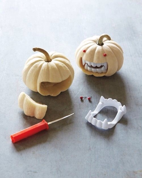 Tiny pumpkins, some red tacks and fake teeth from the dollar store