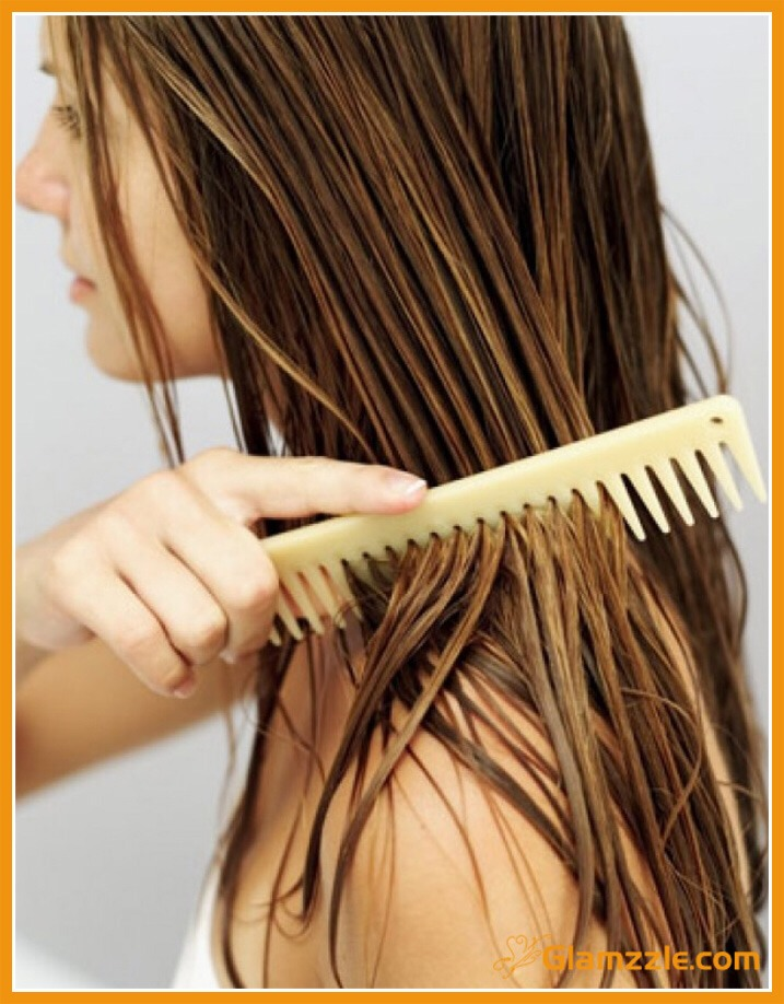 Towel dry and comb tangles out of hair. Apply conditioning treatments or oils focusing on ends and moving up to shaft, avoiding scalp.