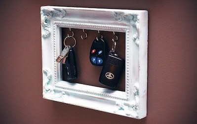 12. Frame Key Holder  Lastly, another great way to DIY key storage is to attach small hooks to the inner rim of an empty picture frame! via The Purple Carrot