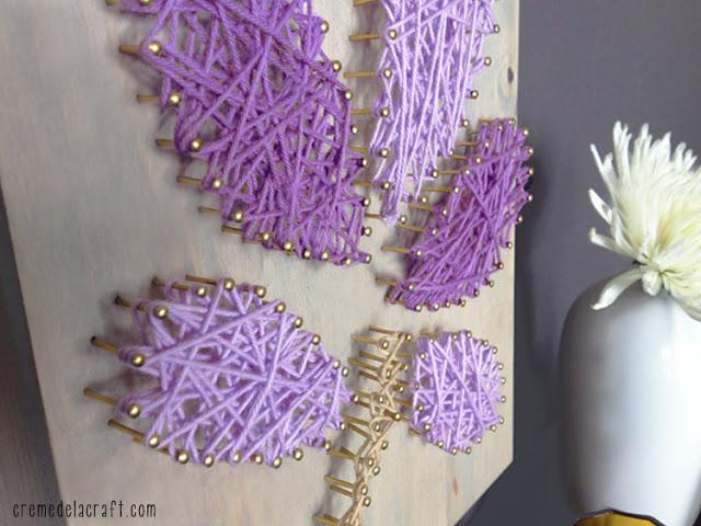 Get creative and experiment with switching between different colors of string. • Once complete, tie the end of the string to one of the nails and cut off any excess.