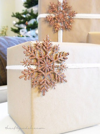 21. Make quick sparkly Pom Poma out of extra tinsel garland and a small amount of string. They're as fancy as those expensive tinsel bows at a tiny fraction of the cost, and take only a minute to make. Learn how HERE | http://blog.potterybarn.com/diy-sparkly-holiday-gift-toppers/