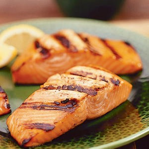 """Grilled fish! Stay away from fried foods, the batter you """"fry"""" your food in and the grease, causes fat. But grilled foods, don't typically add any more calories. (You can buy fat free seasoning)"""