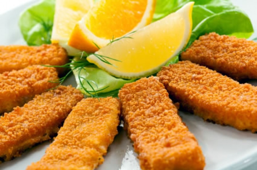 When baking fried foods (like fishsticks) in the oven, before you line the baking sheet with foil, crumple it up before flattening it out and putting it on the sheet. This will help make the food crispier and keep it from sticking.