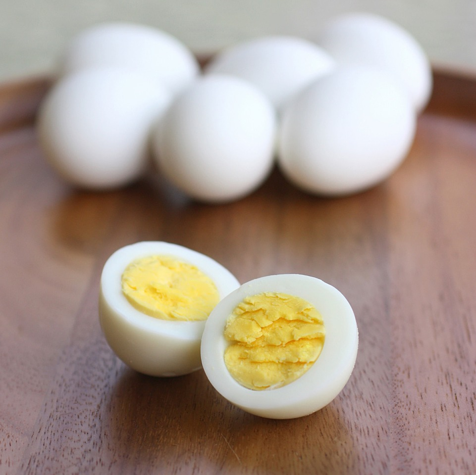 Add eggs to cold water in a pot. Turn heat to high until it boils. Let boil for one minute, cover. Turn heat off and let sit for ten minutes. Transfer to ice cold water (to prevent green ring around yolk). Perfect hard boiled egg every time :)