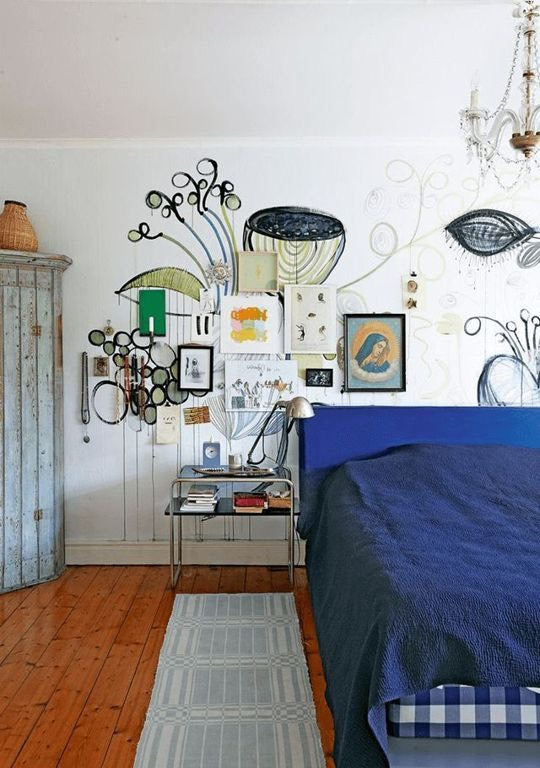 Another way to make a gallery wall stand out: paint a mural on the wall behind. Image fromMy Scandinavian Home.
