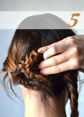 Twist one braid around in a spiral in the back.
