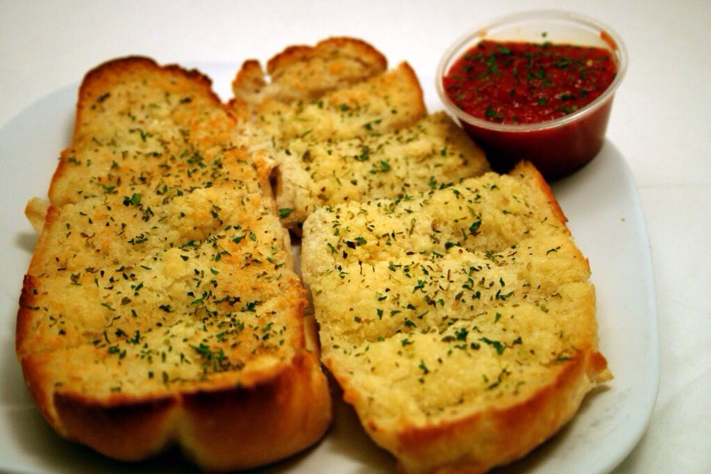 You can also substitute fresh garlic for garlic powder   If you want cheese put on your bread before you put it in the oven   this can be made on any type if bread sandwich rolls, hot dog rolls, Italian bread any thing works! :)