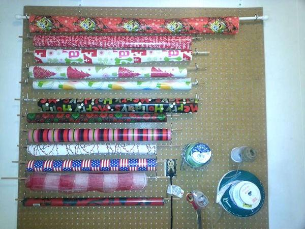 Use rods and dowels on a peg board to organize wrapping paper and provide easy access.