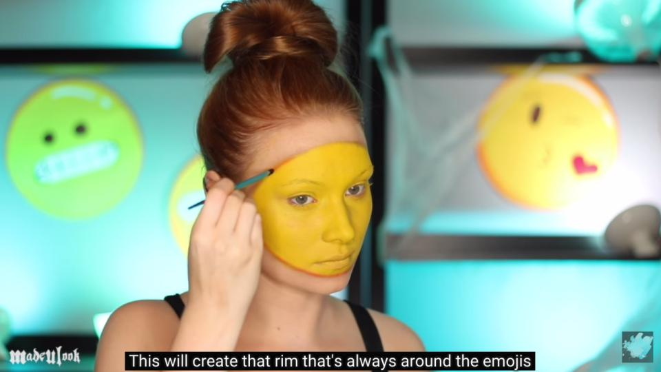 Then, she lines the circle with orange-y eyeshadow to really make the yellow pop.