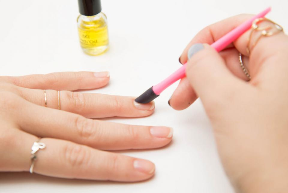 4. Avoid getting any polish on your cuticles, which lifts the paint from the nail and leads to chipping. Don't cut your cuticles, but you can push them back using cuticle oil and an orange stick or a pusher tool to prevent paint from getting on them.