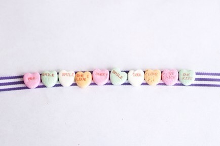 Glue Them On  Attach your conversation hearts to the ribbon with hot glue.