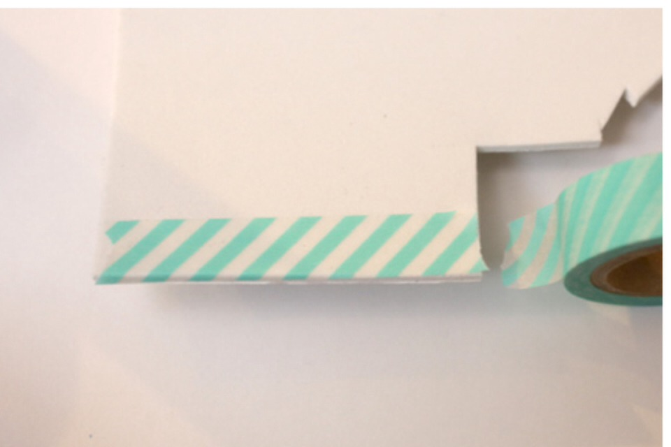 (1) Place a piece of washi tape onto the craft foam.
