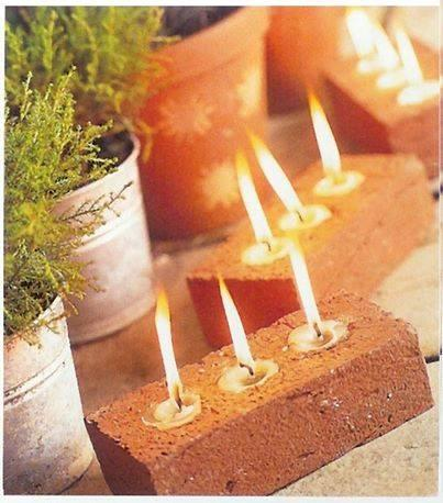 a red brick is perfect because it already typically has 3 holes. Just plug up one side and pour wax with a wic into each hole to make a GREAT decorative candle!
