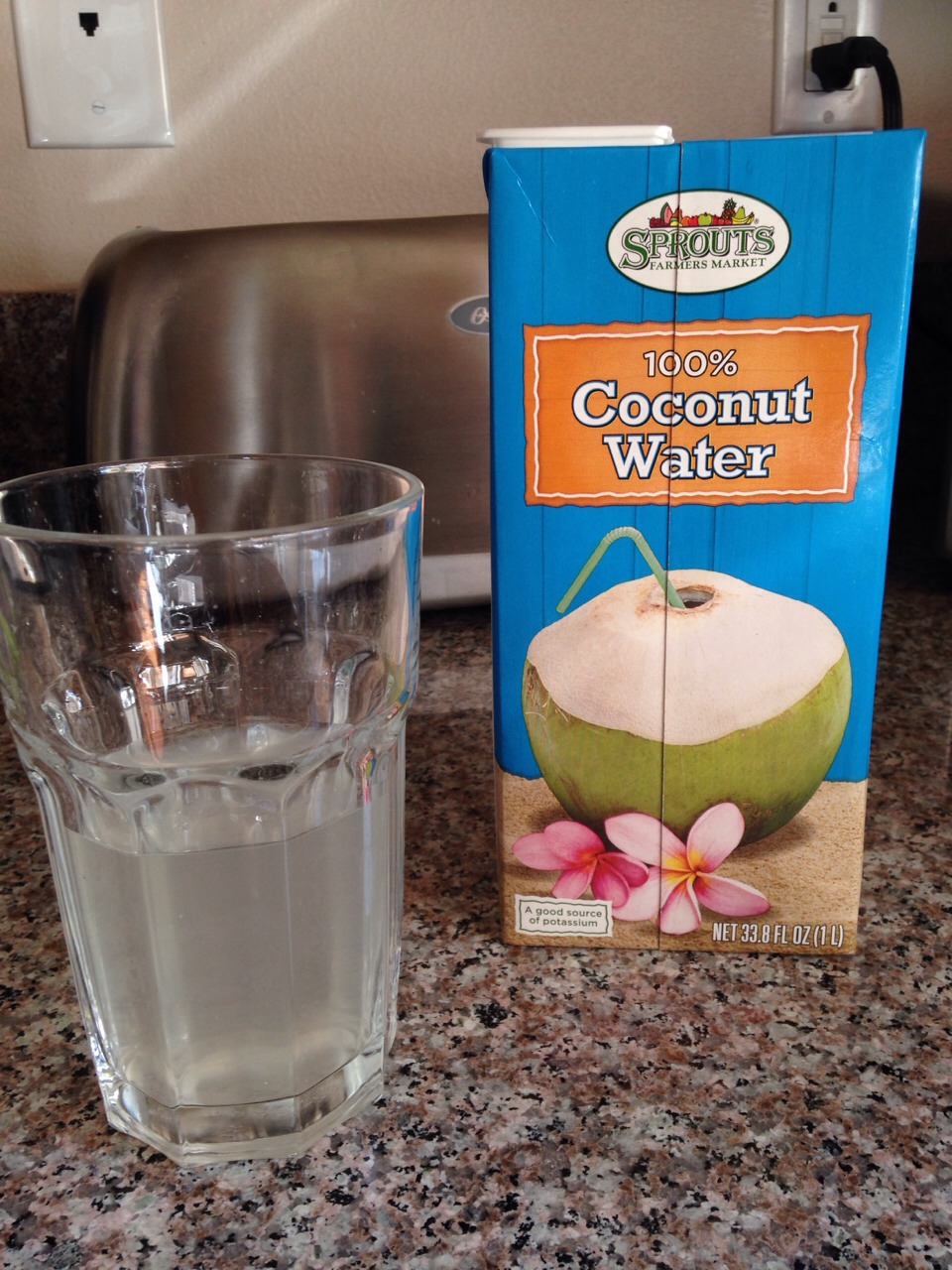 In a glass pour coconut water filling half the glass