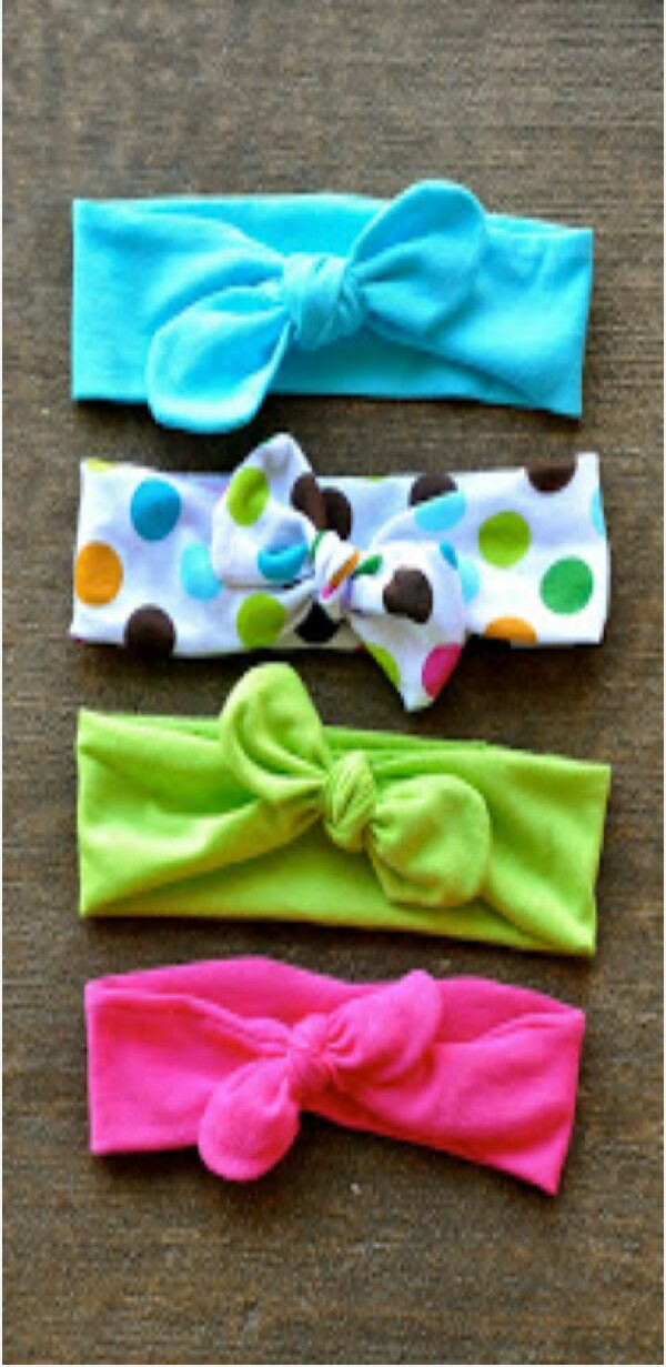 "DIY cute knot bow headbands. You will need jersey fabric (upcycled old t shirt), a sewing machine, thread, paper, straight pins and scissors. Cut about 22""x5"" in fabric (for a 12 month old), after it is cut fold it in half, cut the ends of the fabric to have round edges, pin the fabric and sew it together, leave a little section open to turn the fabric right side out then hand stich the space shut. finally tie the ends in a square knot! here is a link to the tutorial http://morgans2day.blogspot.com/2013/06/diy-top-knot-jersey-knit-headband.html?m=1"