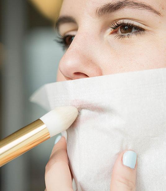 23. To make your lipstick last all day, hold a tissue over your lips and dust them with translucent powder.