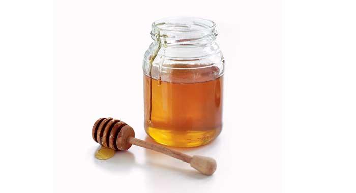 Honey is another ingredient you can add to your bath to moisturise you. Try getting a cup of hot water and adding 2 tablespoons of honey (1 at a time). Stir as you add the honey and it will melt in the water. Pour this in your bath and you won't end up with lumps of honey at the bottom!