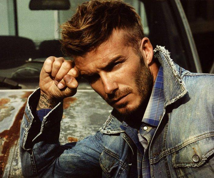 David Beckham rocking an edgy short haircut. With the side being almost skin tight and the top being longer it allows you to do a combover but also giving a casual loose hair look which gives it a more edgy look when the scruff is grown out.