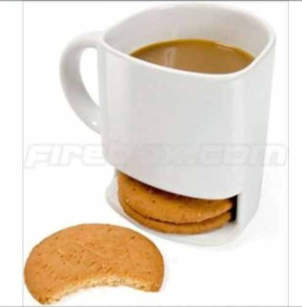 A coffee cup with cookie/cracker storage underneath.