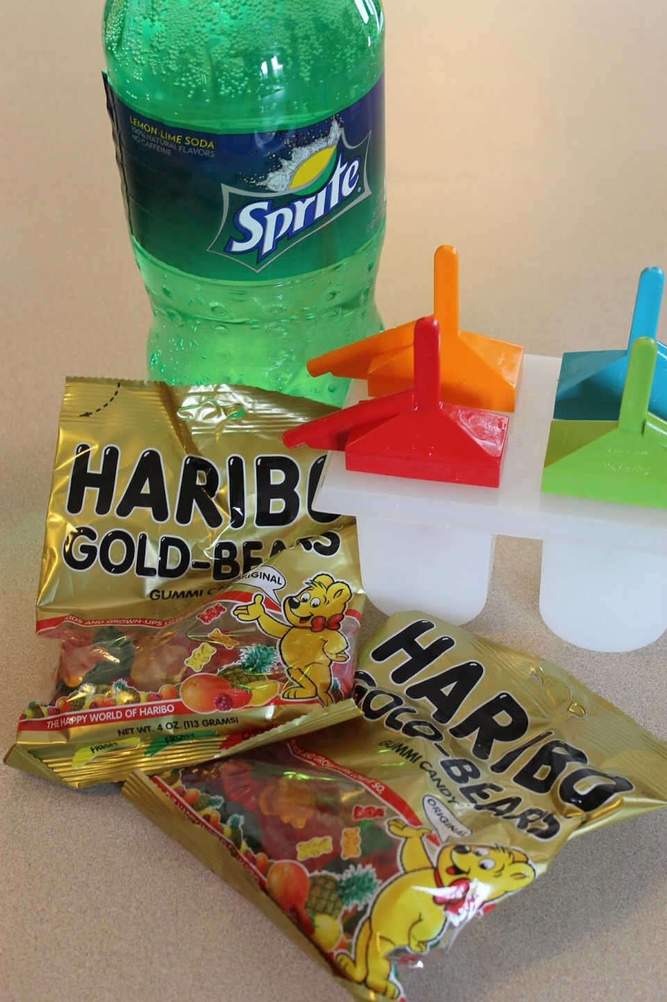 First get gummy bears,sprite,and popcicle thing