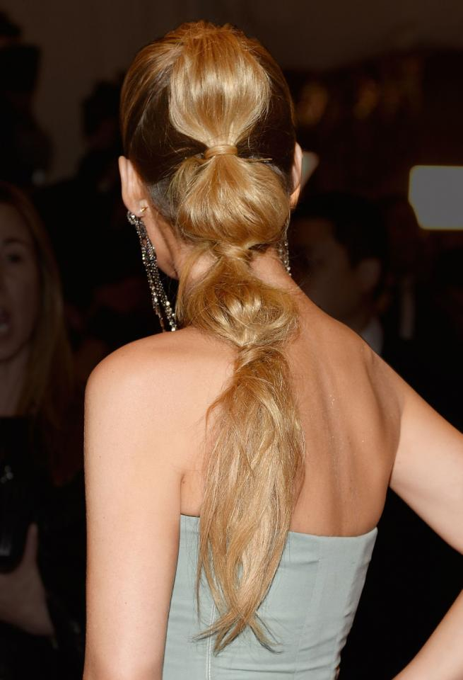 11. Amp up a basic high pony by wrapping a hair elastic every few inches going down the 'tail. Pull apart the sections lightly making a messy-chic look. Experiment with different color elastics for a fun vibe.