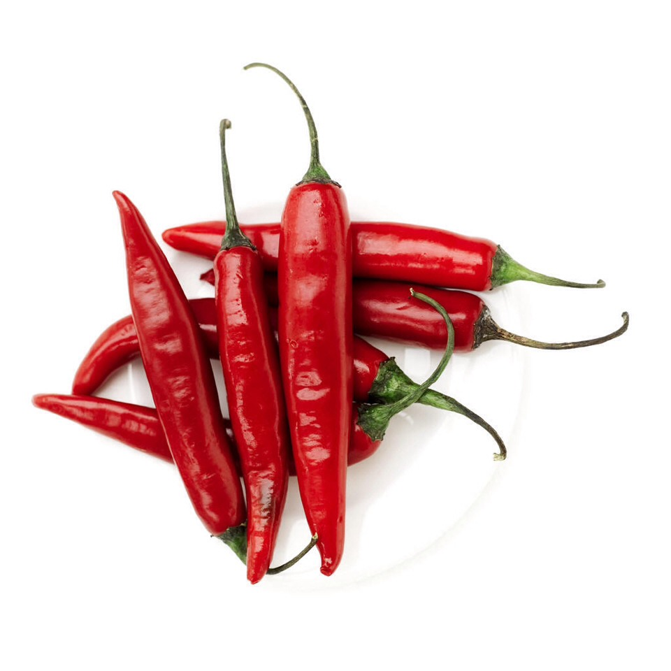 Chilli pepper has a high concentration in vitamin C and anti oxidants which reduce pimples. Crush a chili pepper and add hot water. Apply to pimples with a Q-tip. Do twice daily for best results.