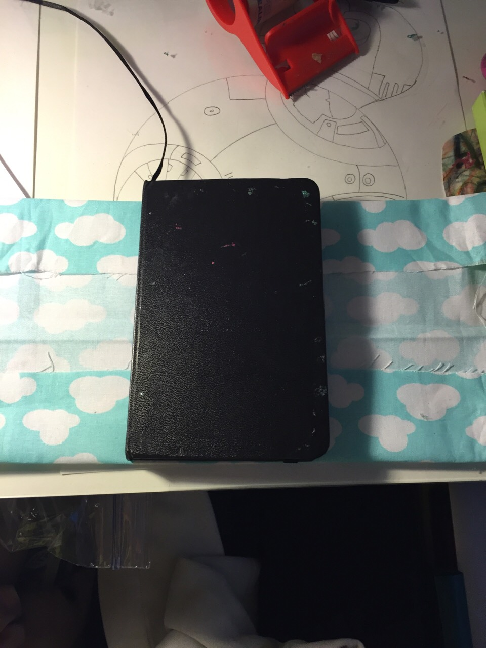 Get your journal and put on the cloth. Then fold it at the top