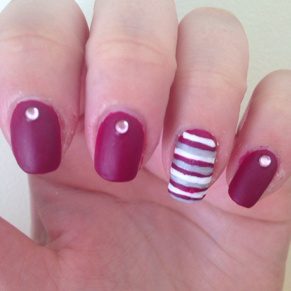 Burgundy nail with pink gem & burgundy silver and white striped accent nail